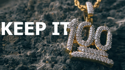 18k Gold Iced Out Cubic Zirconia Emoji 100 Hip Hop Pendant shot outdoors