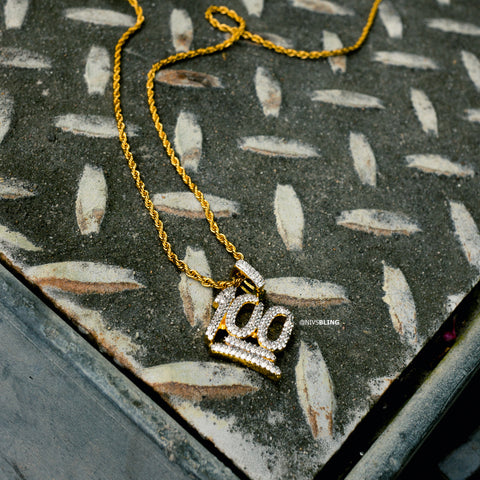 18k Gold Iced Out Cubic Zirconia Emoji 100 Hip Hop Pendant featured on a diamond cut metal
