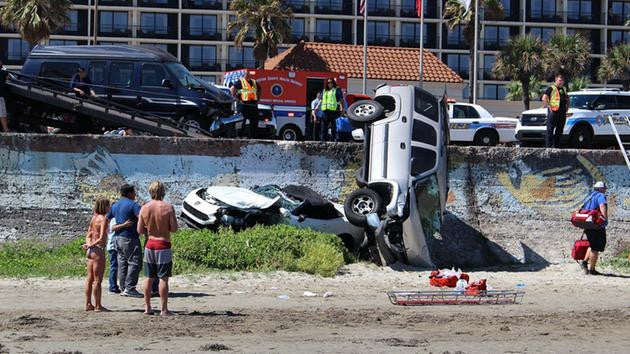 SUSPECTED DRUNK DRIVER SENDS CARS SPRAWLING OVER GALVESTON SEAWALL