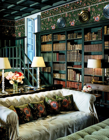 From the book, The Last Swan, the music room has wicker chairs by Res Nova, Turin, and an eighteenth-century Venetian walnut table. Marella Agnelli designed the green-and-pink floral fabric on the walls, curtains, and furniture.