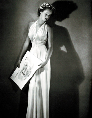 From the book, The Last Swan, Marella Caracciolo di Castagneto, wearing a gown by Gabriella Sport and holding a watercolor by Leonor Fini, circa 1952-53.