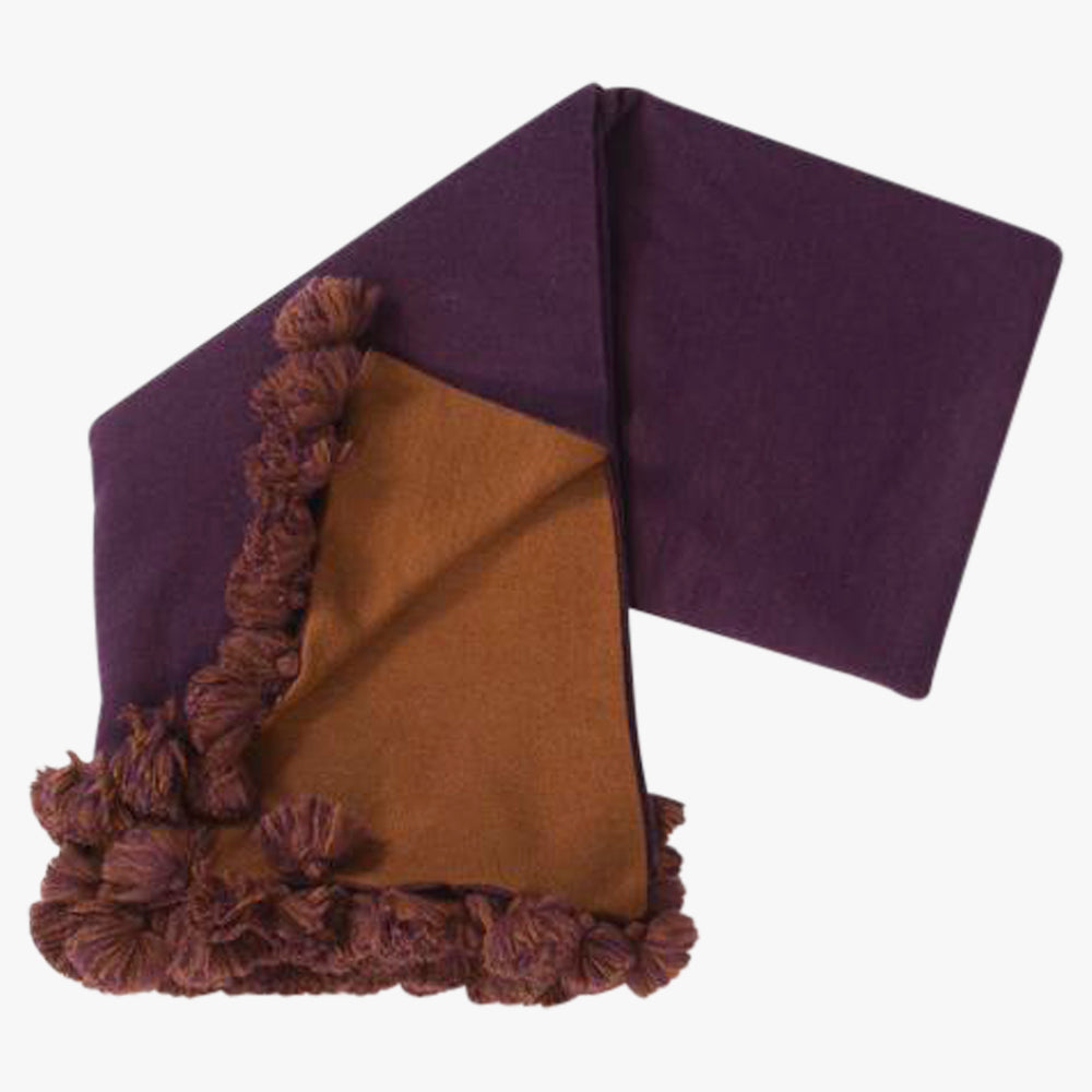 pom pom throw in aubergine and cocoa