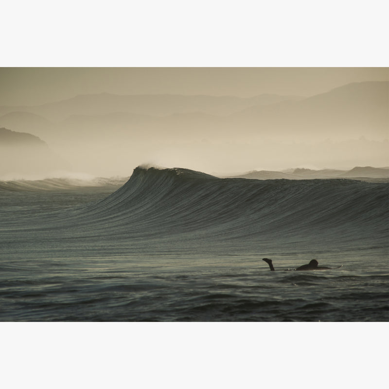 September by César Ancelle-Hansen lone surfer catching a wave