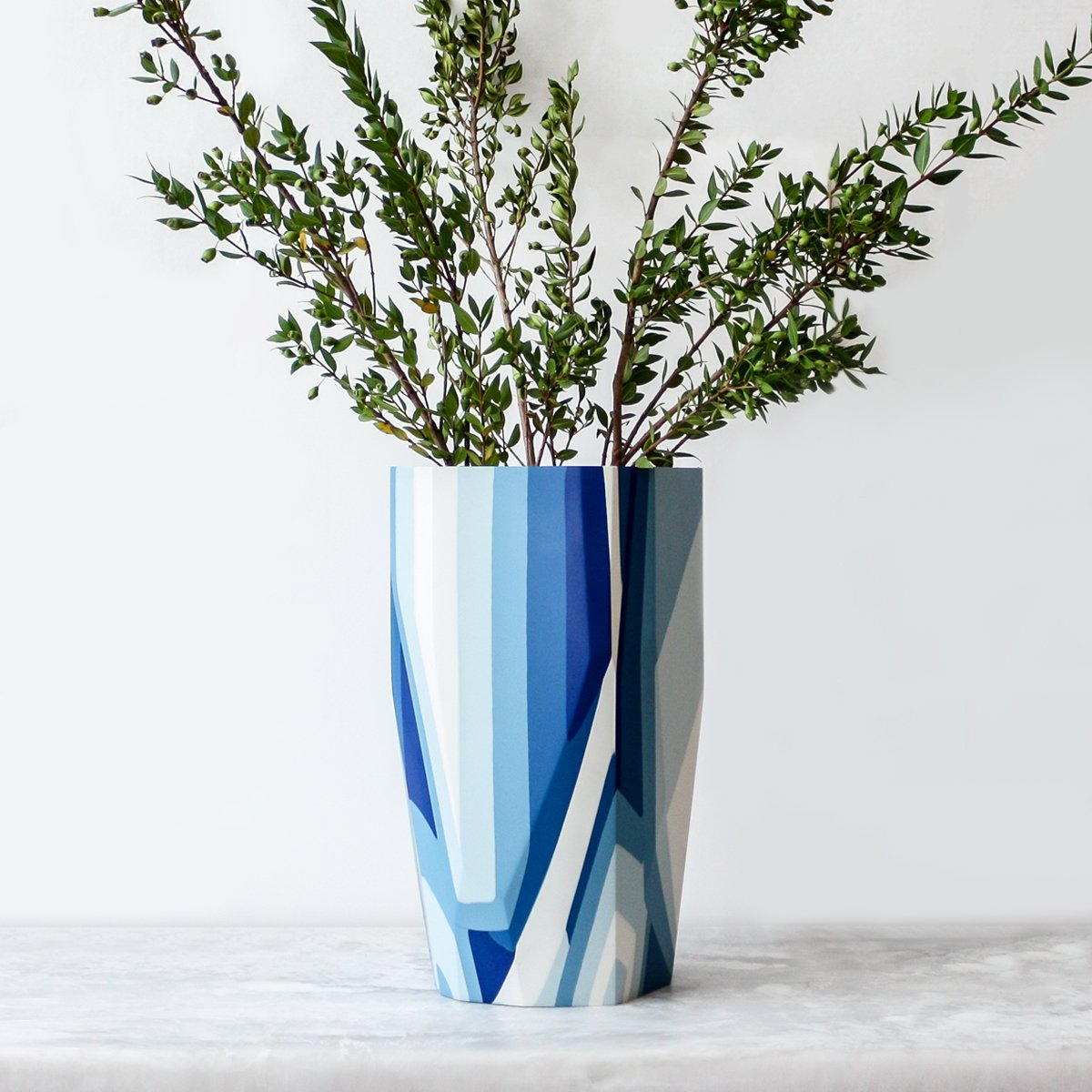Lands End Vase made of resin and plaster in shades of blue by Anyon and Elyse Graham