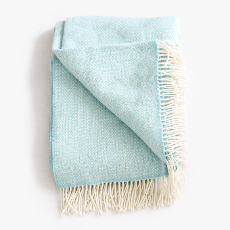 Merino & Cashmere Herringbone Throw in sea foam with a beige fringe by Evangeline