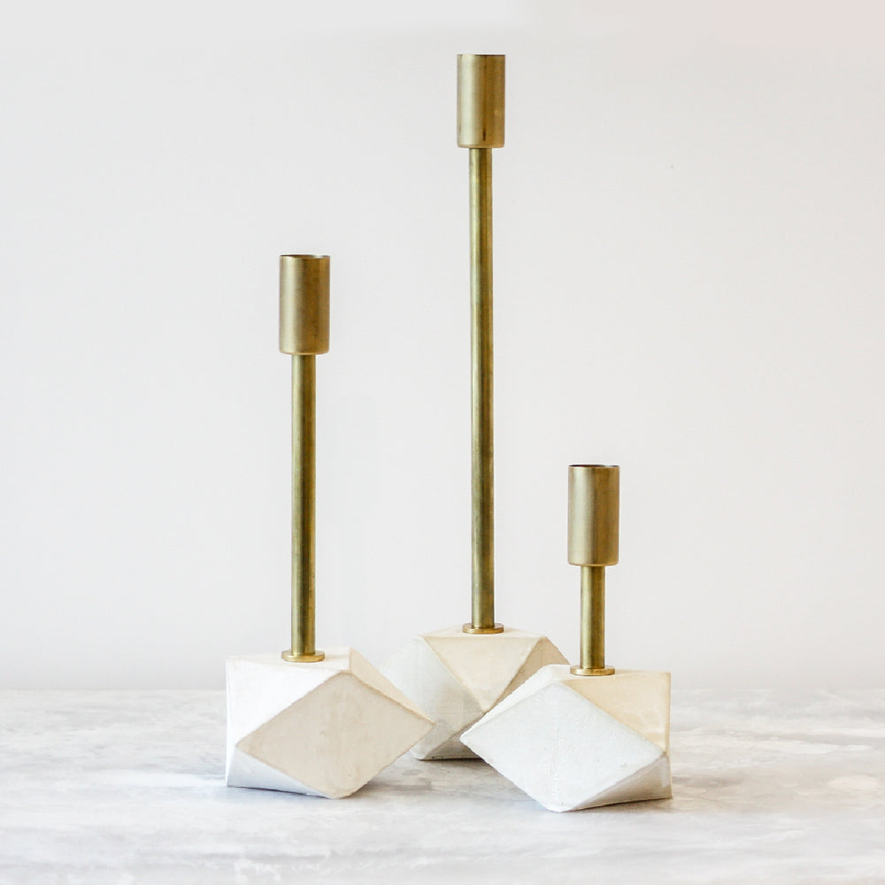 Gem Candlesticks sold as a set of three whitewashed stoneware and unfinished brass by John Sheppard
