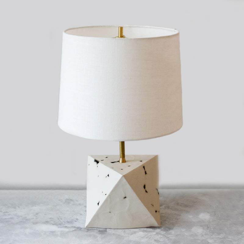 Octa Table Lamp Ceramic with an eggshell linen shade and unfinished brass hardware by John Sheppard
