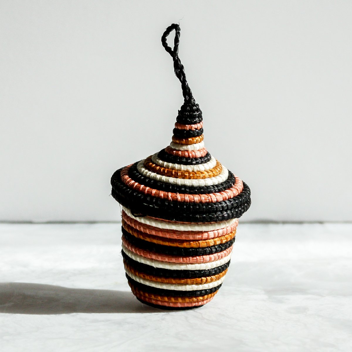 Desert Flower Nya Ornament black stripes made of sisal and sweet grass coral and black by Kazi Goods All Across Africa