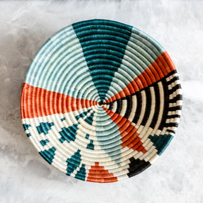 Medium Melon & Teal Biko Bowl made of sisal and sweet grass in orange, teal and navy by Kazi Goods All Across Africa