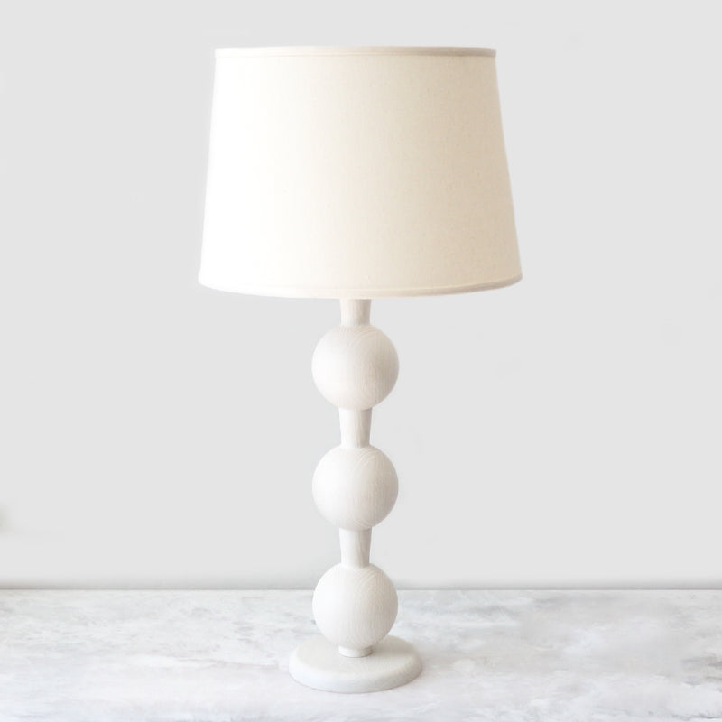 Hugo Barbell Table Lamp made with oak wood in a white wash finish by Lostine