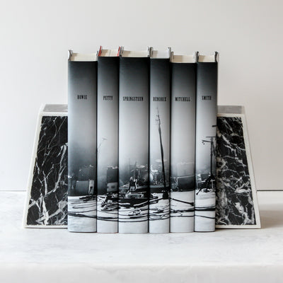 Griffen Marble Bookends holding up books