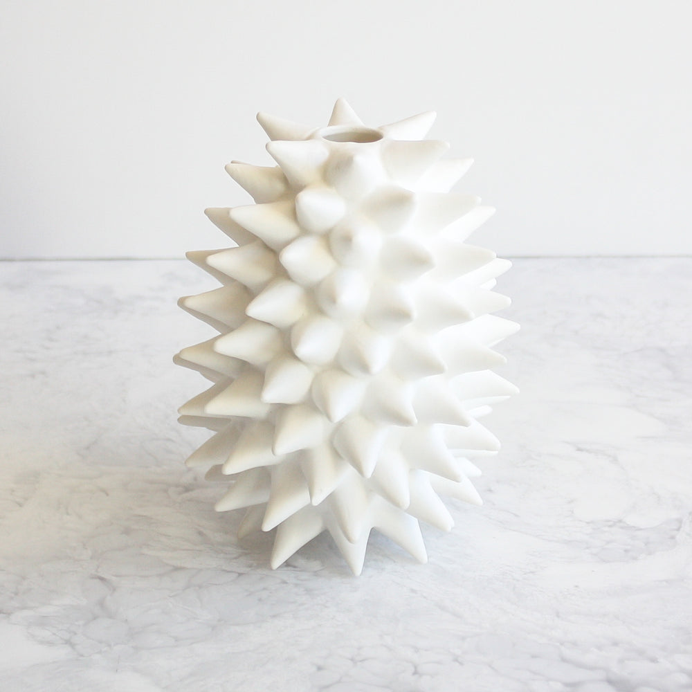Spiked ceramic white vases