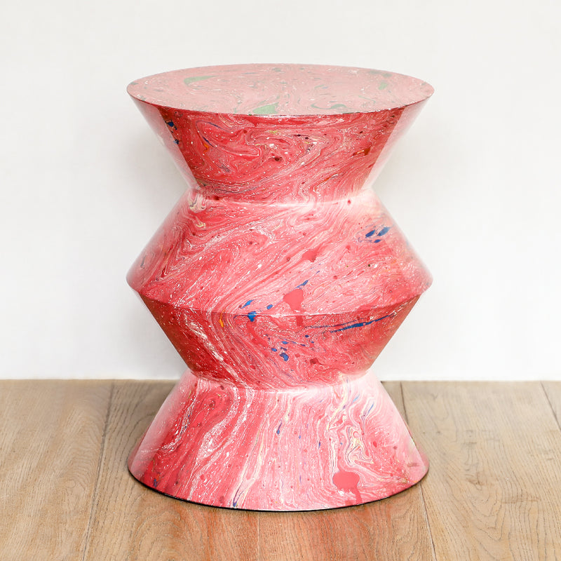 Raine Stool made of lacquered resin in pink swirl by Made Goods