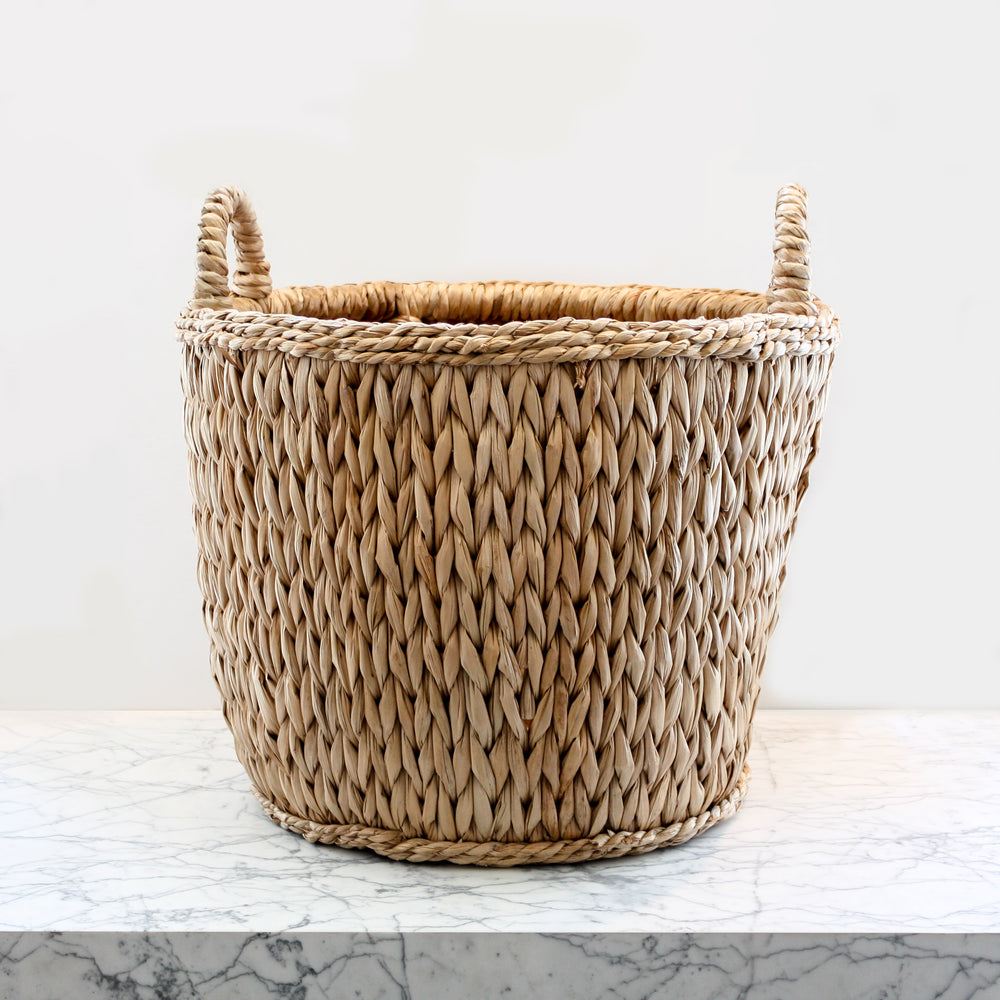 Sweater Weave Log Basket handwoven rattan wicker basket by Mainly Baskets