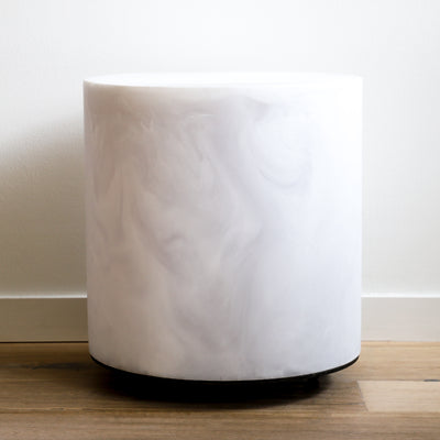 Chief round stool in a white marble finish made of resin with steel castors by Martha Sturdy