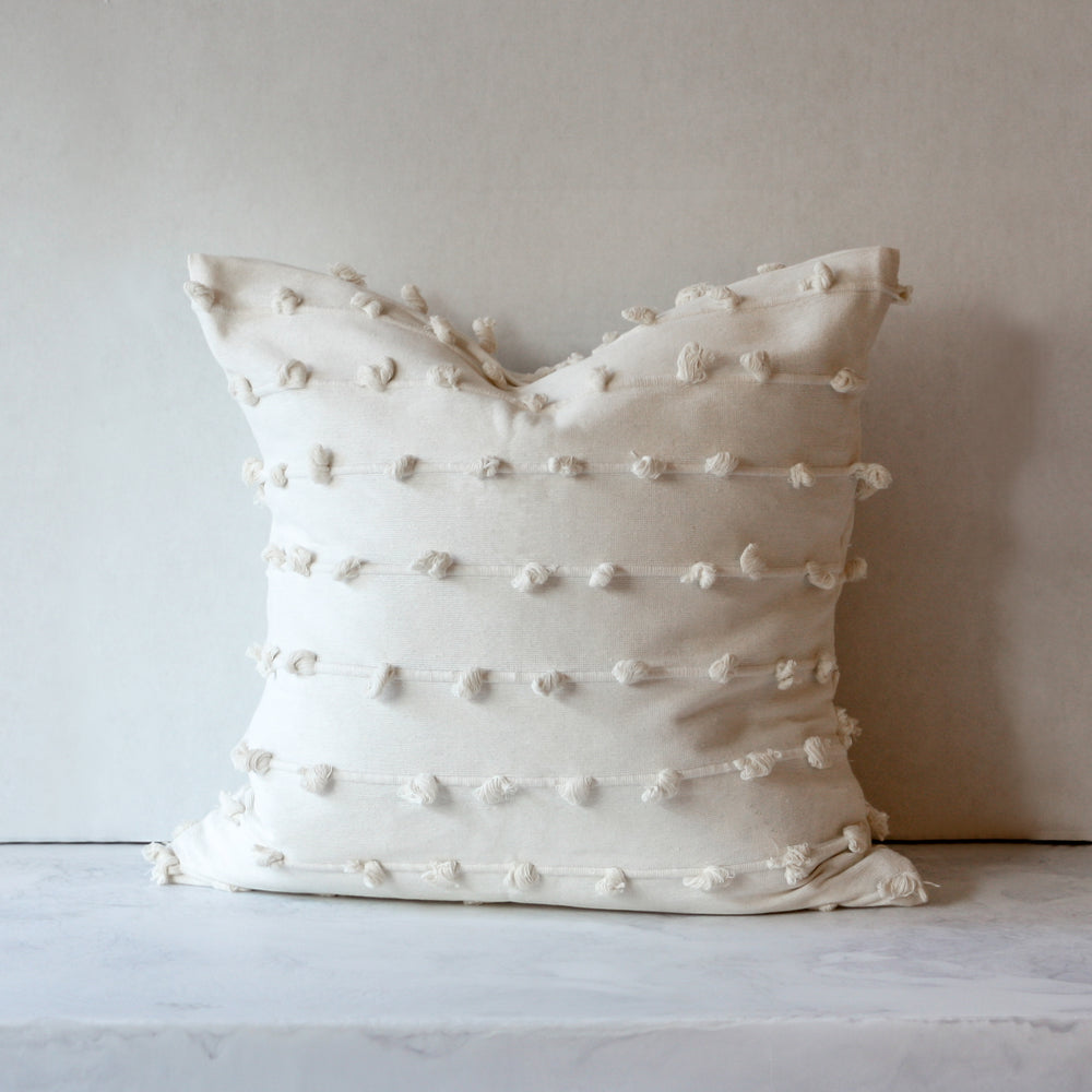 Puff throw pillow in cream