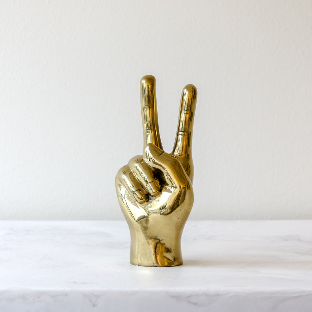 Peace sign hand in brass