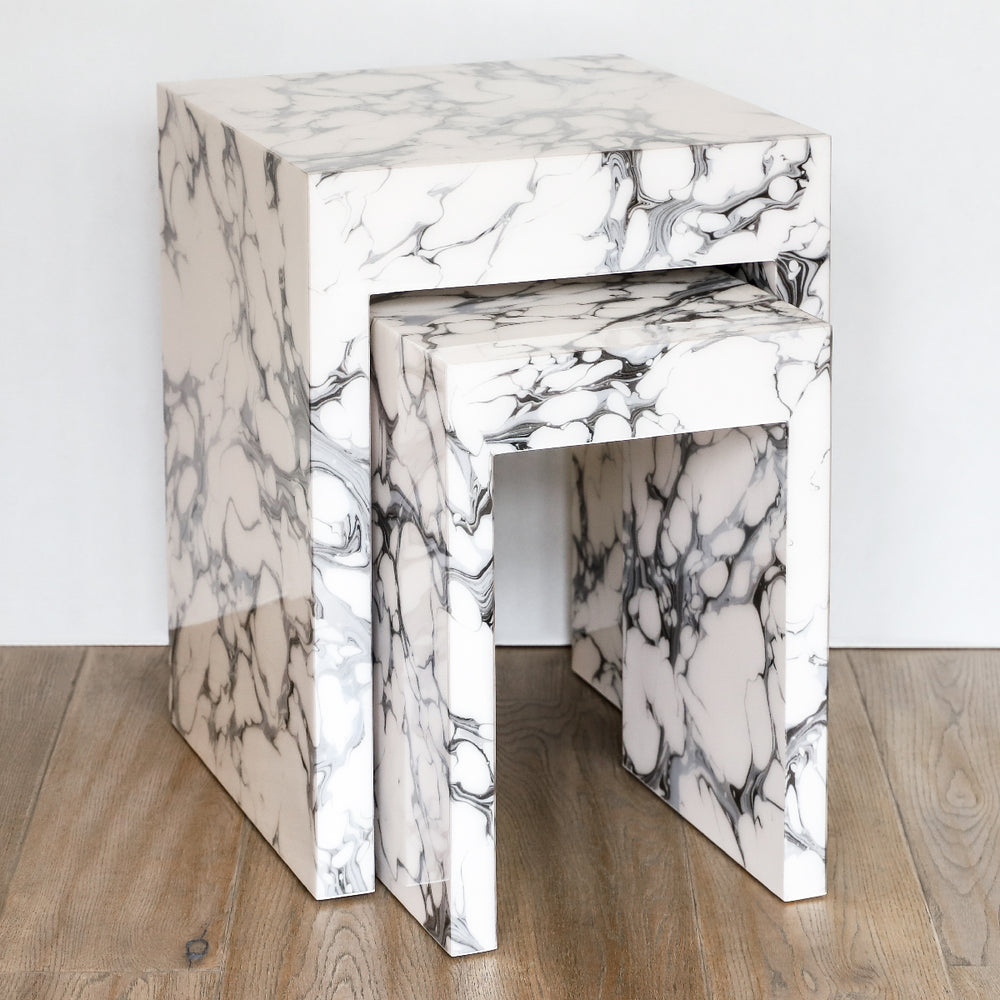 Lacquer nesting tables in cream carrara marble by Pacific Connections