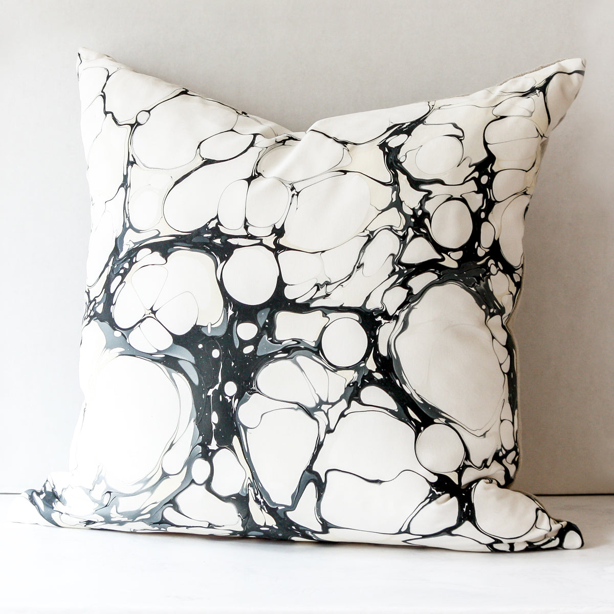 Seastone Bone China Pillow made of silk and Belgian linen in black and white by Rule of Three Studio