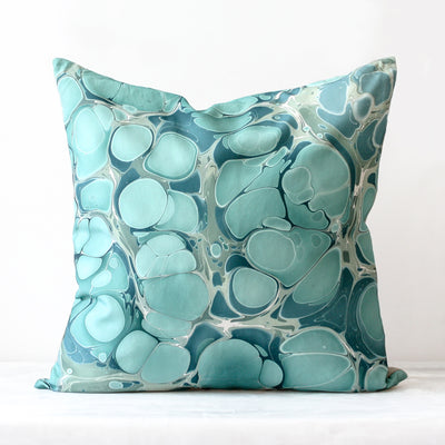 Seastone Seychelles pillow made of silk and Belgian linen in teal by Rule of Three Studio