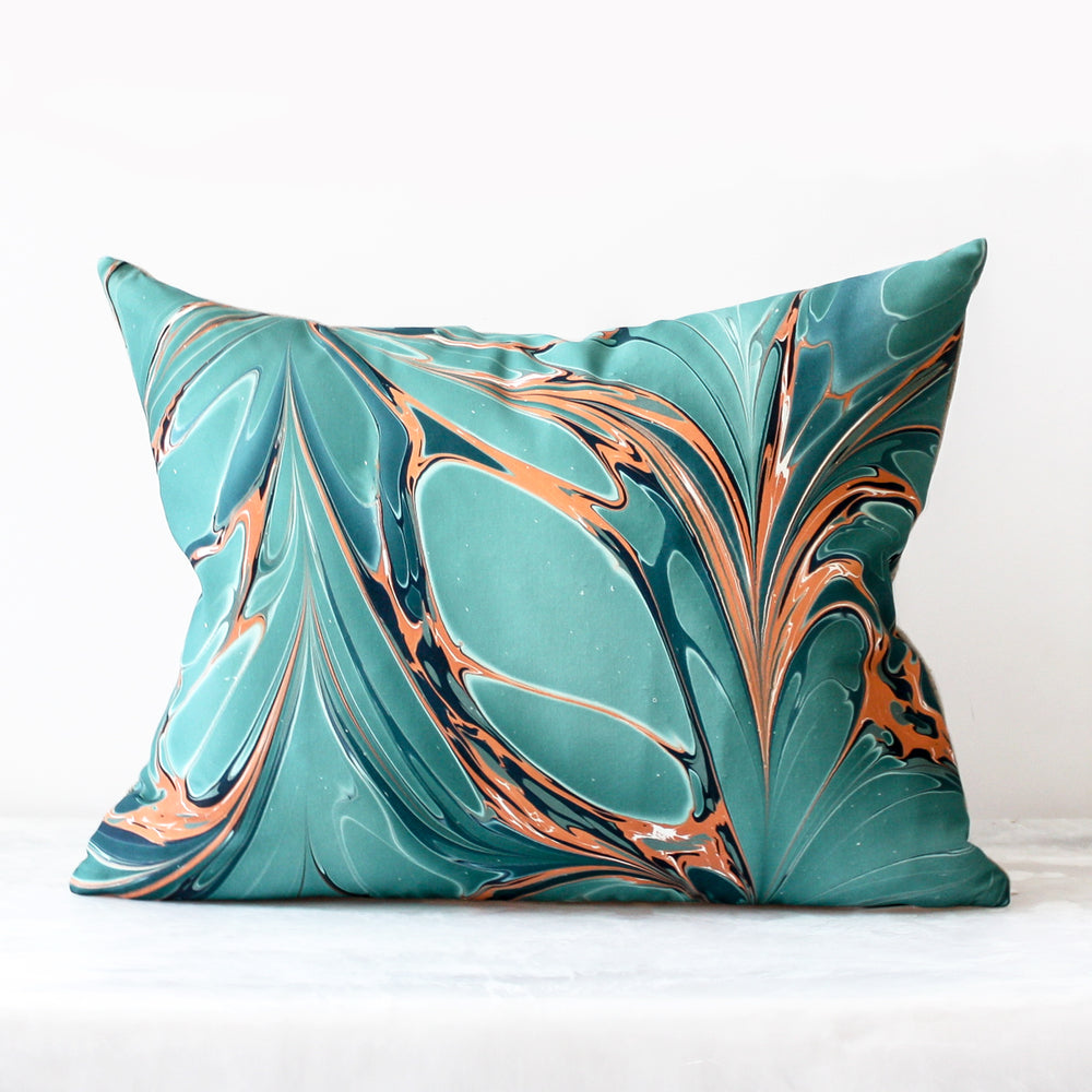 Stone Plume Bird of Paradise lumbar pillow made of silk and Belgian linen in teal and orange by Rule of Three Studio