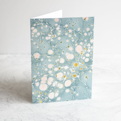 Marbleized greeting cards in golden dust