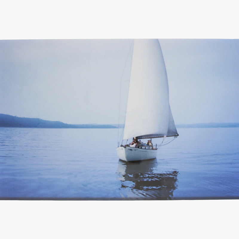 Blue Sailboat photograph by Sara Ferguson