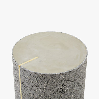 Rubber Cylinder Side Table in gris with brass accents and a concrete top