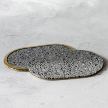 Load image into Gallery viewer, Rubber Coasters in gris with brass edge rim