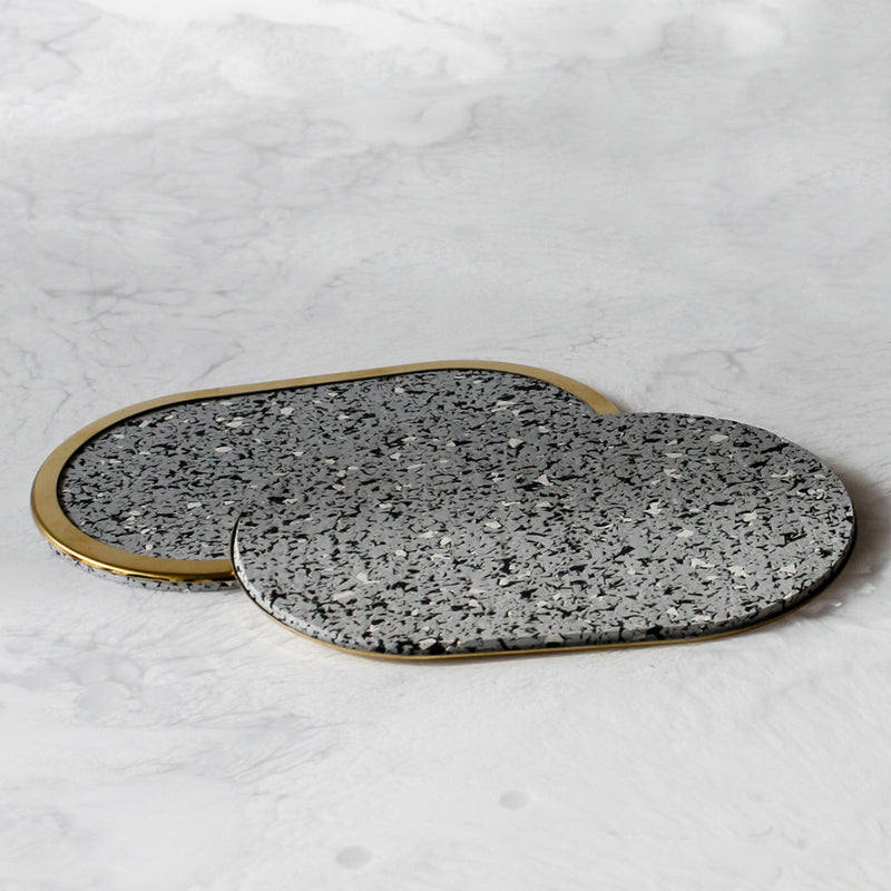 Rubber Coasters in gris with brass edge rim