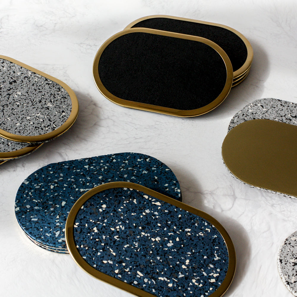 Cluster of rubber coasters with brass
