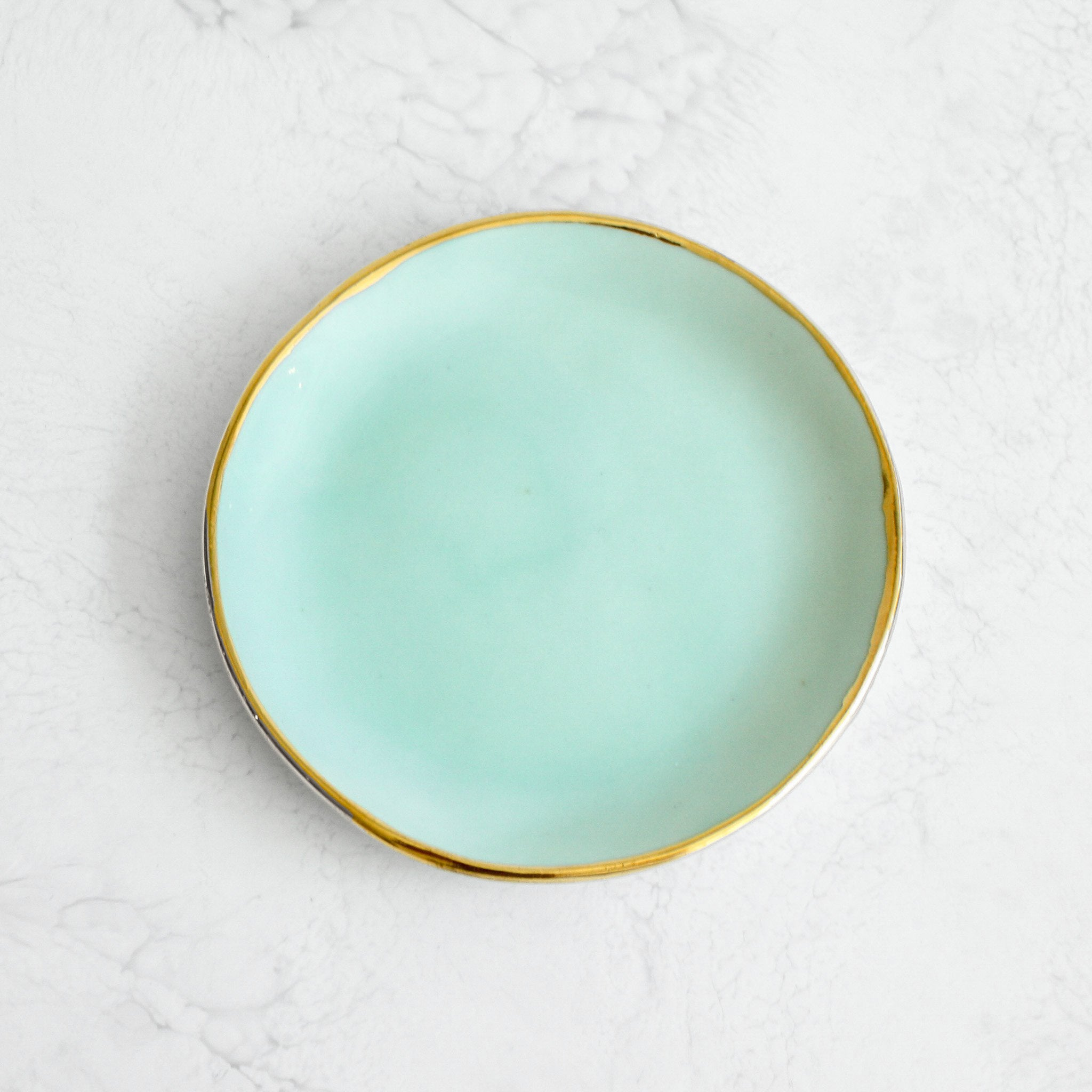 Gold Rim Ring Dishes handmade in a glazed porcelain with a genuine gold rim in mint green by Suite One Studio