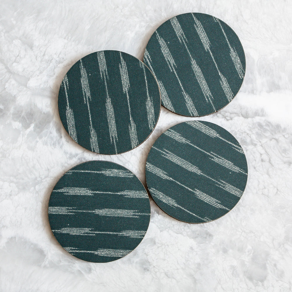 Ikat coasters made of cork and wood in charcoal by Tisch New York