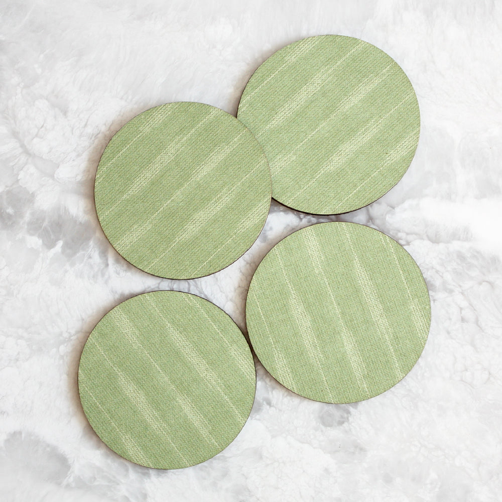 Ikat coasters made of cork and wood in green by Tisch New York