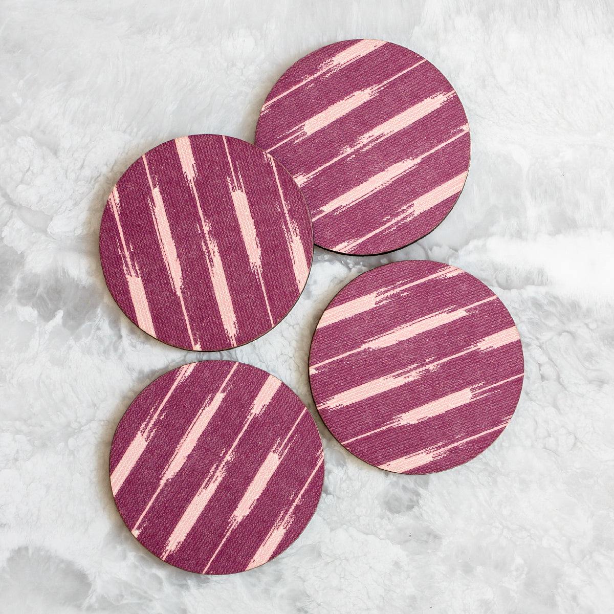 Ikat coasters made of cork and wood in purple by Tisch New York