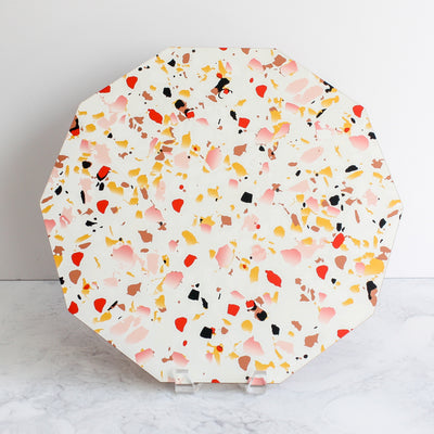 Terrazzo placemats in coral made of cork and wood by Tisch New York