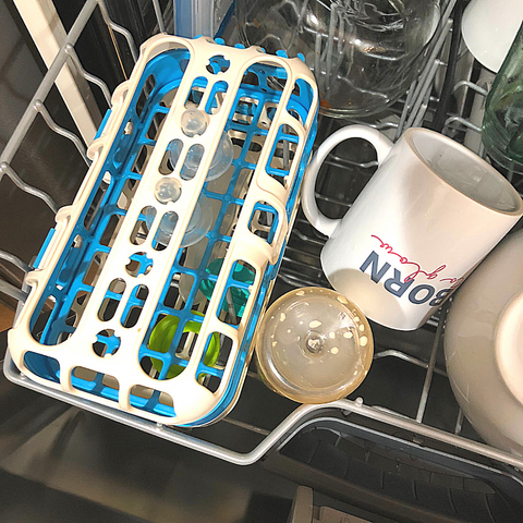 Using a dishwasher to clean your breast pump parts.