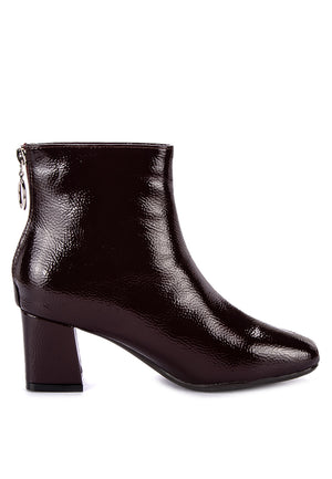 CYRUS PATENT BOOTS