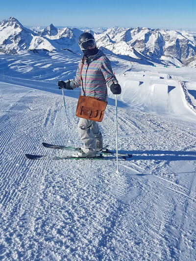Skiing with your Vida Vida leather Satchel