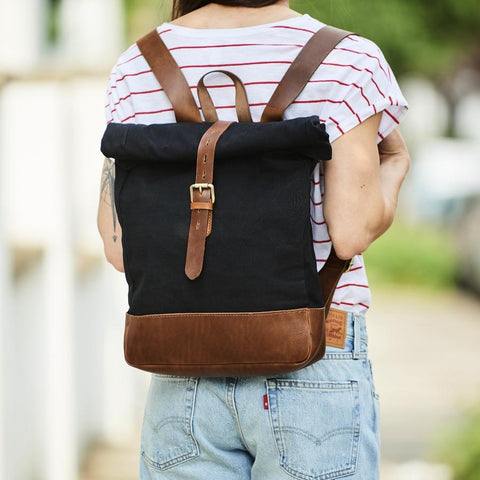 Black canvas and brown leather roll-top backpack