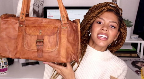 tasha green with a vida vida duffel bag