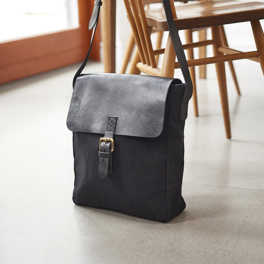 Mens leather and canvas messenger bag in black