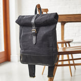 Black leather and canvas rolltop backpack
