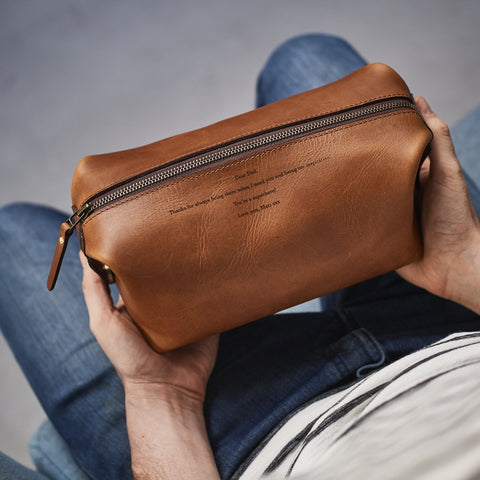 Brown leather washbag with personalised message