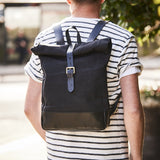 Roll top canvas and leather backpack for men