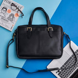 Black leather laptop bag with handle and strap