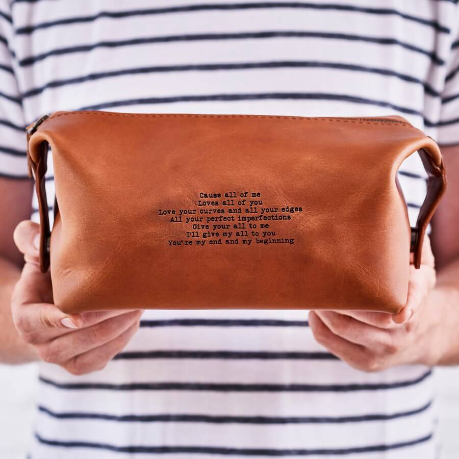 Leather washbag personalised with song lyrics