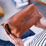 Anniversary leather wash bag with song lyrics embossed