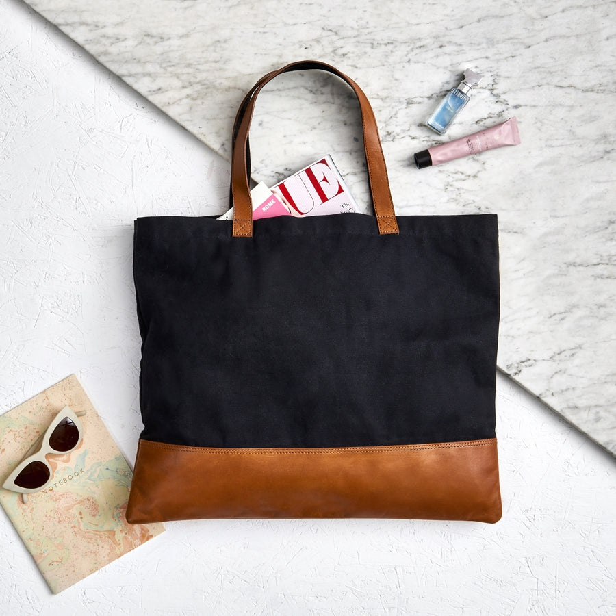 Tan and black large leather tote bag