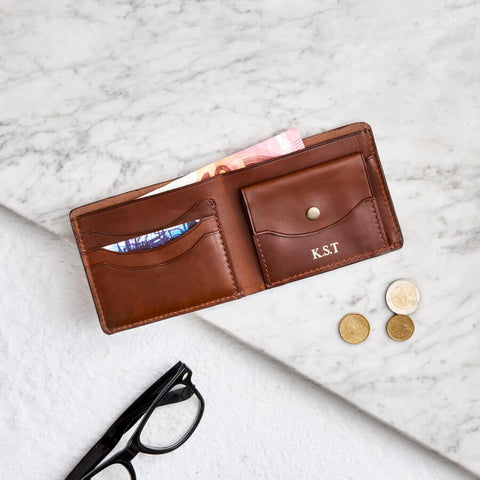 Raw tan leather coin wallet